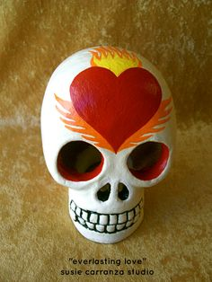 "Handpainted Clay Skull, ""Everlasting Love"".  Flaming winged skull.  Day of the Dead art. $36. Susie Carranza Studio on Etsy."