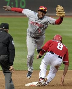 4/14/12: Cincinnati Reds second baseman Willie Harris is unable to tag Washington Nationals' Danny Espinosa during the third inning in Washington.  The Reds lost 4-1.
