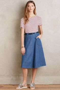 Relax in this pretty + laid back denim skirt this spring.