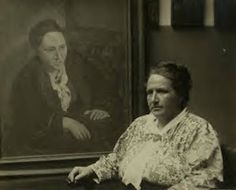 Pablo Picasso was one of Gertrude Stein's favorite artists and social contacts in Paris.Gertrude Stein is shown sitting in front of a portrait of her painted by Picasso. The photo was taken by Man Ray in 1922.