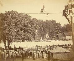 European tightrope walker performing before a large crowd in Baroda (Vadodara, India), c. 1880