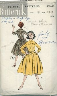 An original ca. 1950's Butterick Pattern 8673.  Bloused button-front shirtdress with front and back yoke, pocket-flap and tab trim.  (A)  Long-sleeved version.  (B)  Roll-up sleeve version.