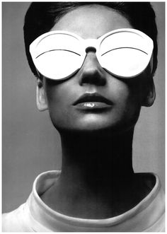 Yet another Avedon I love.  The use of reflection in the glasses is brilliant.