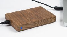 Lifehacker reader Mike Osborne likes his tech to look better than your average black piece of plastic. This beautiful DIY wooden hard drive enclosure is the result.