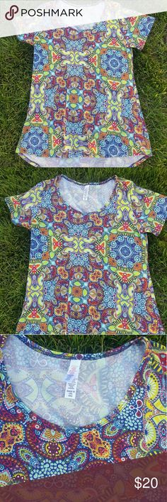 {Lularoe} paisley tunic top Lularoe paisley tunic top (Irma?). Size xxs. 96% polyester 4% spandex. In flawless condition. LuLaRoe Tops