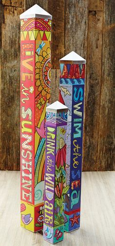"Give artist Susan Black three blank poles to tell a story and this Art Pole Garden was the result. ""Sun, Sea & Air Art Pole Garden"" Set of 3. Art Poles feature artwork laminated onto a lightweight PVC pole for fade-resistance, durability, & reduced shipping cost. Easy to install. Hardware included. Patent pending. $399.95"