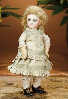 "9 1/2""- Petite French Bisque Premiere Bebe Jumeau in Rare Size 2/0~~ Marks: 2/0 (head). Comments: Emile Jumeau, his earliest bebe, circa 1877.   Original Jumeau dress, undergarments, leather shoes.  Pierced ears."