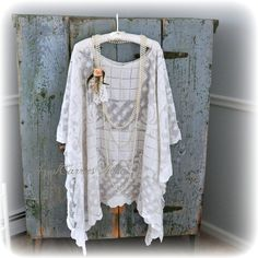 This long lace shawl would be perfect as a bridal shawl, mother of the bride shawl, makes a great boho look with jeans and boots. It is made