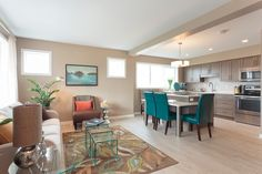 We love the island and eating bar! Oak Park, New Home Builders, Living Spaces, New Homes, Bright, Island, Bar, Table, Furniture