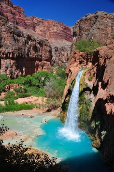 Located near Supai and within the Havasupai Indian Reservation in Grand Canyon National Park is Havasu Falls; a picturesque, hidden gem featuring a main chute that drops nearly 100 ft (30 m) over a vertical cliff into a large pool of blue-green water. Calcium carbonate and magnesium occur naturally in the waters of Havasu.
