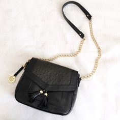 Small leather crossbody Genuine leather. Chain strap with leather piece on top for comfort. Small size but can hold all of your essentials! Bags Crossbody Bags