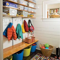 Mini Mudroom - not as purty as some fo the fancier ones, but definitely functional and would have some covered bin storage for gloves, hats, etc; plus has the idea of bins underneath for shoes