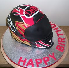 This is a cake I've made for my Dads birthday, it is vanilla sponge with jam and butter cream filling, carved into the helmet shape and covered in fondant icing.