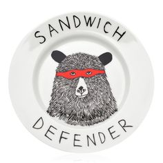 Your sandwiches are safe with this unique and funny plate from Jimbob Art. The 'Sandwich Defender' design is certain to add a touch of humour to meal times. The hand drawn plate perfectly combines beauty, wit and functionality and is available in various designs.  All artwork on the plates are from original, hand drawn designs and are hand applied using a screen printing process.