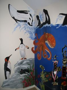penguins, killer whales and an octupus finish out the underwater portion of mural