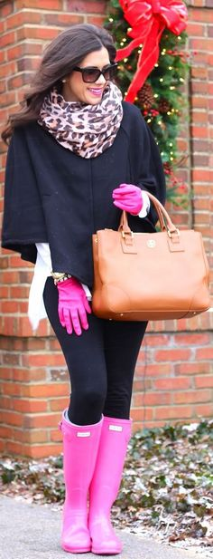 Consider teaming a black cape coat with black leggings for a glam and trendy getup. A pair of hot pink rain boots brings the dressed-down touch to the ensemble.  Shop this look for $400:  http://lookastic.com/women/looks/sunglasses-scarf-cape-coat-tote-bag-watch-gloves-leggings-rain-boots/7172  — Black Sunglasses  — Beige Leopard Scarf  — Black Cape Coat  — Tobacco Leather Tote Bag  — Gold Watch  — Hot Pink Leather Gloves  — Black Leggings  — Hot Pink Rain Boots