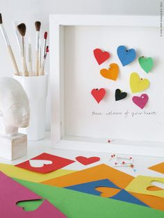 Deep frame with pinned paper hearts. Inspiration from IKEAs Swedish blog http://livethemma.ikea.se/node/30033