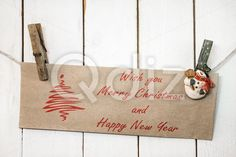 Qdiz Stock Photos | Christmas snowman clothespins holding greeting card,  #background #brown #card #Christmas #closeup #clothesline #clothespin #craft #decoration #decorative #eve #figure #fun #funny #greeting #hanging #holding #holiday #little #Merry #new #object #paper #pin #postcard #rope #small #snowman #toy #traditional #white #wood #wooden #xmas #year