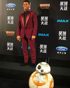 #JohnBoyega wore a custom ‪#Versace‬ #burgundy one button #tuxedo with notch lapels at the #Shanghai #premiere of #StarWars‬.   Of course #BB8 is looking #dapper as well.   #VersaceCelebrities‬  #TheForceAwakens #StarStyle