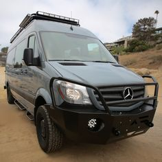 Mercedes Sprinter from Johnson Custom Van Solutions with Aluminess front bumper, and roof rack.