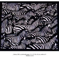 Beautiful paper cut zebras by Béatrice Coron. I don't know if it is hand cut or laser cut...