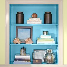 Use an accent color to create a focal point. This vibrant blue draws attention to a built-in bookcase.