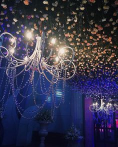 Illuminated chandeliers suspended from a roof of roses. Because little details create huge impacts. By 3productionweddings wedding planners