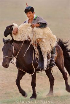 Man on horseback with lost sheep, Hustain Nuruu National Park, Mongolia someday I will go to Mongolia!