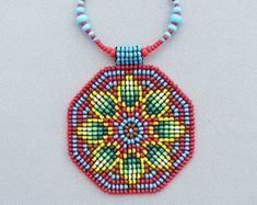Items similar to Seed Beaded Mandala, Sacred Geometry Necklace, Mandala Necklace, Native American, Art Jewelry. Green yellof flower on red. on Etsy Beaded Rings, Beaded Jewelry, Beaded Necklace, Native Beadwork, Native American Beadwork, Loom Beading, Beading Patterns, Sacred Geometry, Bead Weaving