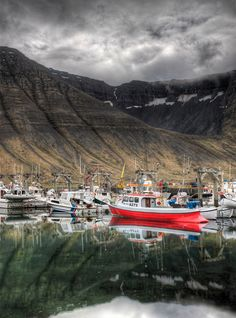 As soon as I drove into Isafjordur in the very remote area of NW Iceland, I went right to the docks. The water was so calm and perfect that it was beyond belief. I was super-tired, and I thought that the still water MUST be a unique phenomenon, so I toughened up to go take a bunch of photos. - ICELAND, ISAFJORDUR - photo from #treyratcliff Trey Ratcliff at http://www.StuckInCustoms.com