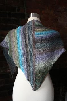 Takes 1 skein Noro Kureyon Sock and pattern is $4 @ http://chiagu.com/collections/shawl-patterns/products/chaya-shawl-knitting-pattern