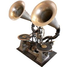 The First DJ Mixer (1910): The Gaumont Chronophone System synchronised sound and film at the Gaumont Palace in Paris. A skilled operator could switch between them to give a more or less continuous soundtrack.