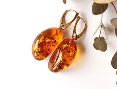 Large unique golden amber earrings, beautiful shape amber earrings, natural amber jewelry, shiny massive amber earrings, gem stone earrings by AmberDesign8 on Etsy