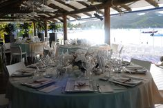 Custom peach & dusty aqua dip-dyed tablecloths give off a beachy vibe for this St. Barth's wedding designed by Alchemy Fine Events.  www.alchemyfinevents.com