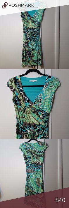 Laundry Faux Wrap Feather Patterned Dress Excellent pre-owned condition, no flaws, no damages, no stains, or signs of wear. Faux wrap style, slightly gathered at the waist and includes a narrow matching tied belt. The material is quite stretchy, drapes very well and has a very soft feel. The base color is turquoise with an abstract feather design. Measurements in the picture. Laundry By Shelli Segal Dresses Midi