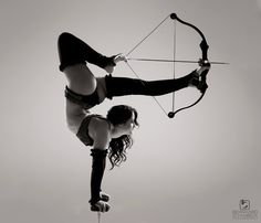 Trick shot with a compound bow. Model is Cristina Garcia. Photography by Bernhard Schambeck.