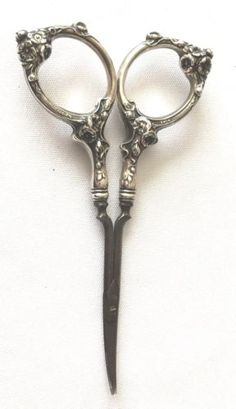 "German Sterling Silver Handled Scissors 4 3/4"". The Scissors part are marked Germany. Handles have a very pretty design and are marked Sterling and have what looks like anL and 3414. 