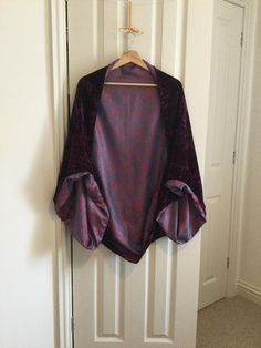 I have one item ready to ship. large oversized Burgundy wine crushed velvet shrug, shawl, kimono. Crushed velvet is a textured irregular pile fabric, which reflects light and has a soft drape effect. My own envelope design, Great for 1920's flapper vintage mood. The shape is a flattering shrug, Flapper Fashion, Flapper Style, Envelope Design, Burgundy Wine, Pattern Cutting, Crushed Velvet, Shawl, Paisley, Crushes