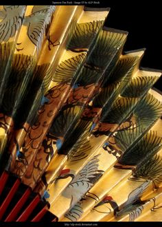 Japanese fan - reminds me of the large fan my mother-in-law gave me. Same yellow color & with cranes.