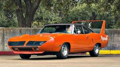 At the height of the American auto industry& muscle car war, there was one that literally stood above all others - the Plymouth Superbird. Built to satisfy NASCAR regulations requiring a production run, the Superbird started the NASCAR aero wars. American Auto, American Muscle Cars, Plymouth Superbird, Dodge Daytona, Pontiac Gto, Pontiac Firebird, Us Cars, Car Manufacturers, Classic Cars