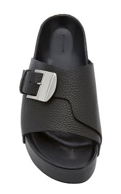 Not quite a flip flop, not yet a slide; Simon Miller's chunky sandals are an effortless way to appear laid-back. Slide Sandals, Women's Shoes Sandals, Leather Sandals, Leather Slippers For Men, Mens Slippers, Birkenstock Yara Sandals, Leather Men, Black Leather, Fashion Slippers