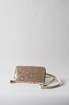 Fleur Simple styles of this group feature flower embossed metallic foil coated leather. These sophisticated handbags are easy to wear and ma...