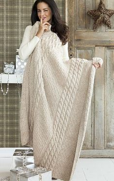 Afghan Patterns Bulky wool -- quick to knit, cozy, especially in this oatmeal, cabled pattern easy enough for advanced beginner. - This inviting oatmeal afghan is as attractive as it is comfy, with cabled columns segmenting a field of broken ribbing. Knitting Patterns Free, Knit Patterns, Free Knitting, Vogue Knitting, Square Patterns, Knitted Afghans, Knitted Blankets, Yarn Projects, Knitting Projects