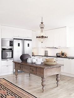 I love this idea to use a vintage piece as a kitchen island