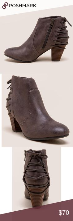 Distressed Laced Back Booties The short and sassy bootie features a lace-up tie detail in the back that's sure to turn heads. Waxed faux leather upper/Man-made lining/Man-made sole/Heel height 2.75'' Brown Report Shoes Ankle Boots & Booties