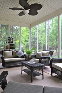 relaxing screened space with dark wicker furniture