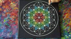 "Watch as Elspeth McLean applies her unique ""Dotillism"" style to the Sacred Geometry Flower of Life pattern in vibrant rainbow colours. Original time of video..."