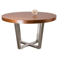 Showcasing a stainless steel frame and round wood top, this elegant dining table adds a touch of contemporary style to your decor.  Produ...