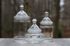 Set of Three Clear Glass Apothecary Jars with Lids - Candy Jars, Bathroom Storage Jars -  Terrarium Jars by theretrobeehive on Etsy https://www.etsy.com/listing/218663360/set-of-three-clear-glass-apothecary-jars