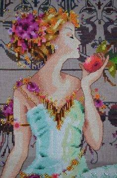 Persephone is the title of this beautiful cross stitch pattern from Mirabilia. The cross stitch design features Persephone with lotus flowers behind her and the story of Persephone is that she returns once a year from the underwrold to return to her mother Demeter and herald the beginning of spring. Dressed in her beautiful aquamarine Victorian gown, she is surrounded by cranes, symbols of happiness, good forture and longevity.